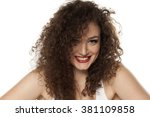 smiling girl with long curly... | Shutterstock . vector #381109858