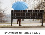 Rainy Day  Woman Siting On...