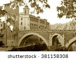 Small photo of A glimpse of the island Tiberina and the river Tiber edella its architecture - Rome - Italy