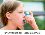 girl uses an inhaler during an... | Shutterstock . vector #381182938