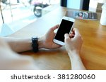 man holding smartphone with... | Shutterstock . vector #381280060