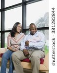 parents with newborn baby | Shutterstock . vector #381282844