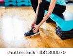 fit brunette girl with black... | Shutterstock . vector #381300070