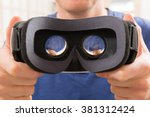 Stock photo man using virtual reality headset at home 381312424
