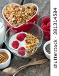 healthy snack   granola on... | Shutterstock . vector #381314584