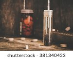 manganese and tablets in jar on ... | Shutterstock . vector #381340423