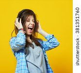 Small photo of young teenage woman wearing headphones listen to music and sing with open mouth over colorful yellow background
