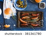 grilled sausages in oven pan... | Shutterstock . vector #381361780