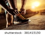 man tying jogging shoes | Shutterstock . vector #381415150