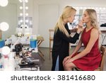 makeup artist applies lipstick. ... | Shutterstock . vector #381416680