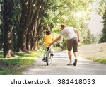father help his son ride a... | Shutterstock . vector #381418033