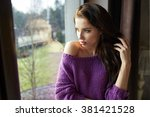 pensive woman standing by the...   Shutterstock . vector #381421528