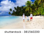 family with child walking on... | Shutterstock . vector #381560200