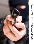 aiming murderer with a gun | Shutterstock . vector #381627796