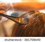 process of coloring hair with... | Shutterstock . vector #381708640