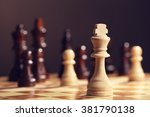 chess pieces and game board on... | Shutterstock . vector #381790138
