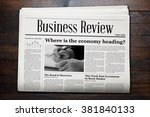 business newspaper on wooden... | Shutterstock . vector #381840133