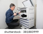 repairman working with printer... | Shutterstock . vector #381883999