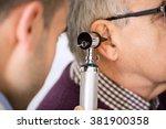 doctor examining old patient's...   Shutterstock . vector #381900358