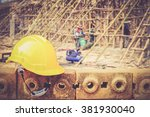 safety helmet with blur people at under construction area - stock photo