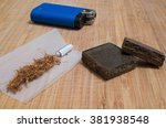 pieces of hashish tobacco joint ... | Shutterstock . vector #381938548