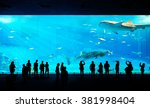 silhouettes of people and giant ... | Shutterstock . vector #381998404