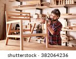 serious furniture designer... | Shutterstock . vector #382064236