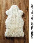 Sheepskin Carpet On Wooden...
