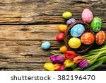 Easter Eggs And Tulips On...