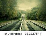 Dark Asphalt Road Under A Stor...