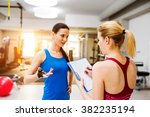 woman in gym  personal trainer  ... | Shutterstock . vector #382235194