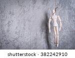 wooden figure of human hanging... | Shutterstock . vector #382242910