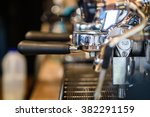 prepares coffee in his coffee... | Shutterstock . vector #382291159