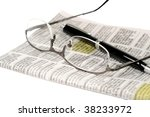 Glasses and pen over a newspaper classifieds page - stock photo
