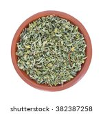 Small photo of Top view of a portion of damiana leaf in a small bowl isolated on a white background.