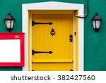 photo of a yellow front door... | Shutterstock . vector #382427560
