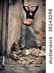 Young woman fashion in a ruined building. - stock photo