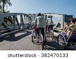 rickshaw ride in hue | Shutterstock . vector #382470133