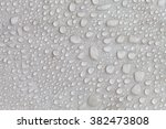 splashed water drops on the... | Shutterstock . vector #382473808