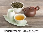 tea set with clay teapot on... | Shutterstock . vector #382516099