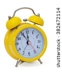 Small photo of Clock. Alarm clock, in a yellow box, on a white background. Isolated