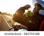driver motorcycle drink water  | Shutterstock . vector #382703188