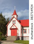 Small photo of AKUREYRI, ICELAND - SEPTEMBER 10: St Peter's Parish Church is a typical small wooden church with red roof in the city of Akureyri, Iceland and is pictured on September 10, 2015.