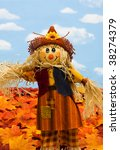 A Scarecrow Sitting On Fall...