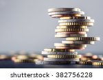 Euro coins stacked on each...