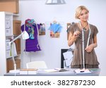 young fashion designer working... | Shutterstock . vector #382787230