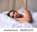 pretty woman lying  in bed | Shutterstock . vector #382831543
