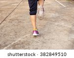woman running on the road... | Shutterstock . vector #382849510