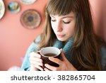 beautiful young woman drinking... | Shutterstock . vector #382865704