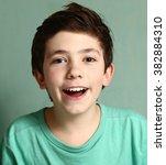 Smiling Laughing Preteen Boy...